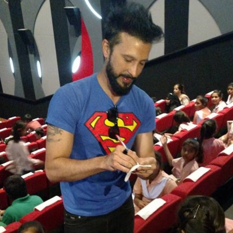 Good guy Kazmi signing autographs for fans
