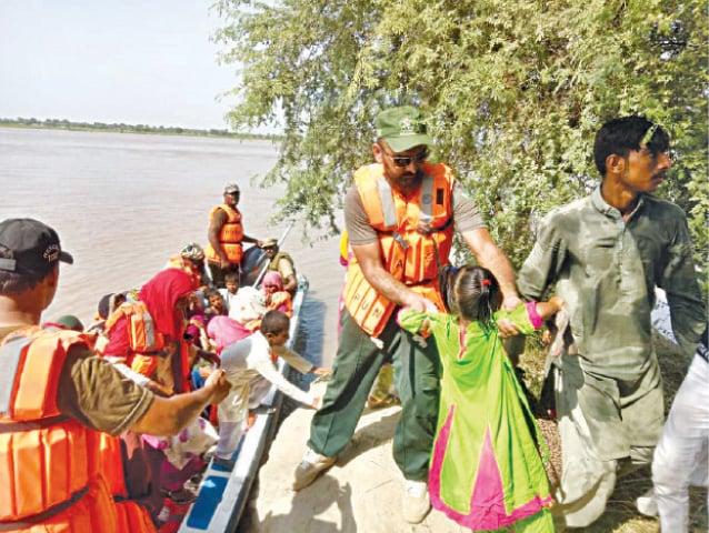 BAHAWALNAGAR: Rescue operation in a village hit by flood. — Dawn