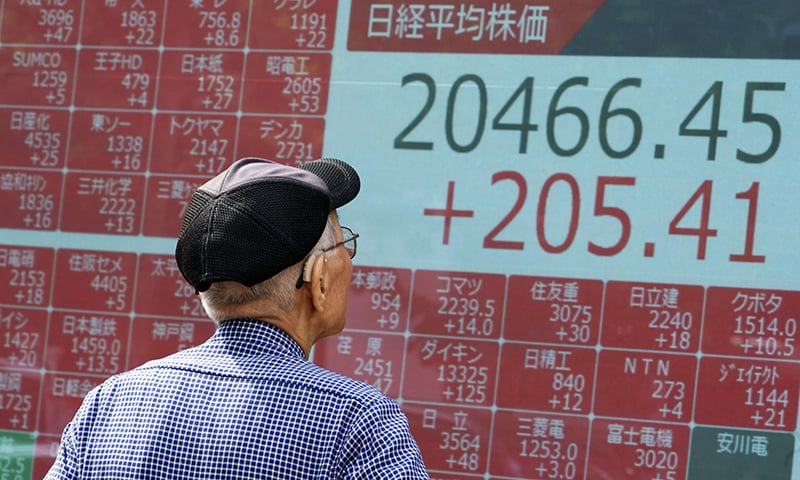 A man looks at an electronic stock board showing Japan's Nikkei 225 index at a securities firm in Tokyo on Tuesday, Aug 27, 2019. — AP
