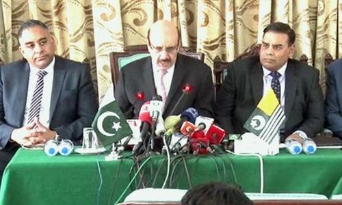 Barrister Imran Hussain (L) addresses a joint press conference alongside Azad Jammu and Kashmir (AJK) President Masood Khan (C) and British MP Khalid Mahmood (R). — DawnNewsTV
