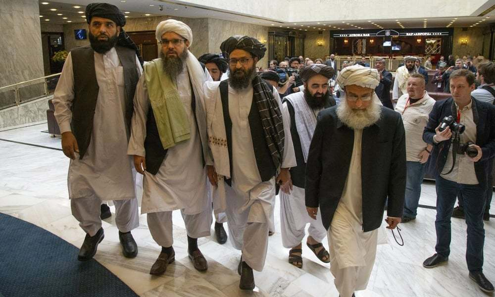 In this May 28, 2019 file photo, Mullah Abdul Ghani Baradar, the Taliban group's top political leader, third from left, arrives with other members of the Taliban delegation for talks in Moscow, Russia. — AP