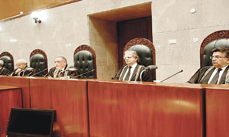 ISLAMABAD: Chief Justice of Pakistan Asif Saeed Khosa (centre) presiding over a full-court reference on Justice Sheikh Azmat Saeed's retirement on Tuesday.—INP