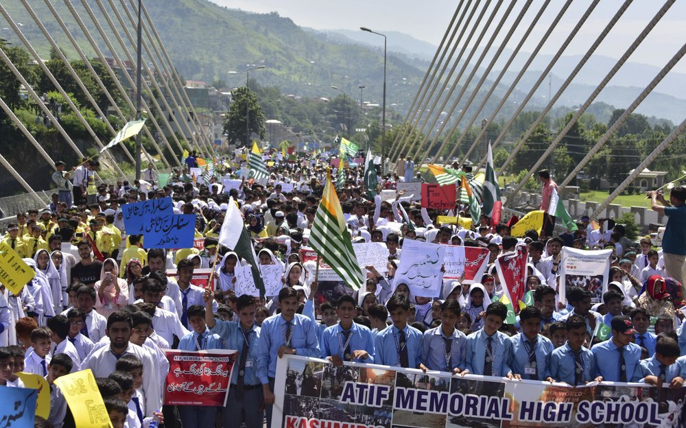 Students in Muzaffarabad rally to express solidarity with Kashmiris in occupied Kashmir on Tuesday. — AP