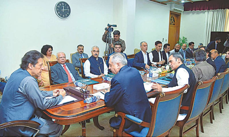 ISLAMABAD: Prime Minister Imran Khan chairs a meeting regarding ease of doing business at PM Office on Wednesday. — APP