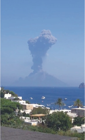 PANAREA (Italy): Smoke rises from Stromboli volcano on Wednesday in this still image obtained from social media video.—Reuters