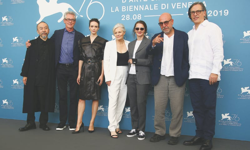 Jury members Shinya Tsukamoto (from left), Piers Handling, Stacy Martin, Mary Harron, Jury President Lucrecia Martel, Paolo Virz and Rodrigo Prieto pose for photographers at the Venice Film Festival on Wednesday.—AP