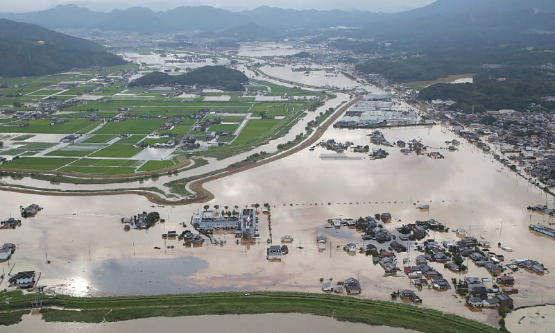 An aerial view shows submerged houses and buildings after heavy rains in Omachi, Saga prefecture, on Wednesday.—AFP