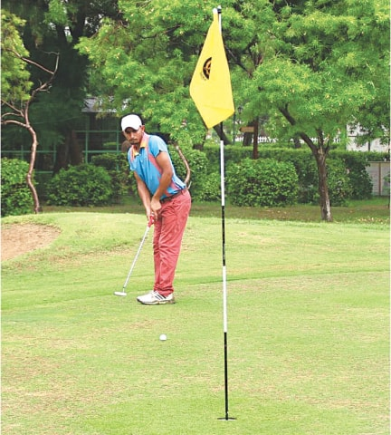 A competitor attempts a putt during the opening round of the CNS Open Golf Championship at the Karachi Golf Club on Thursday.—INP