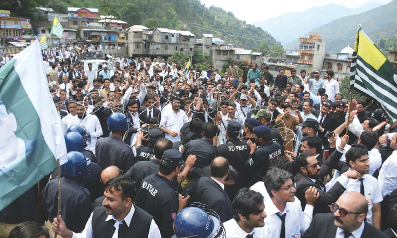 POLICE try to stop protesting lawyers from reaching the Line of Control at Chakothi, in Azad Jammu and Kashmir, on Thursday. — AP