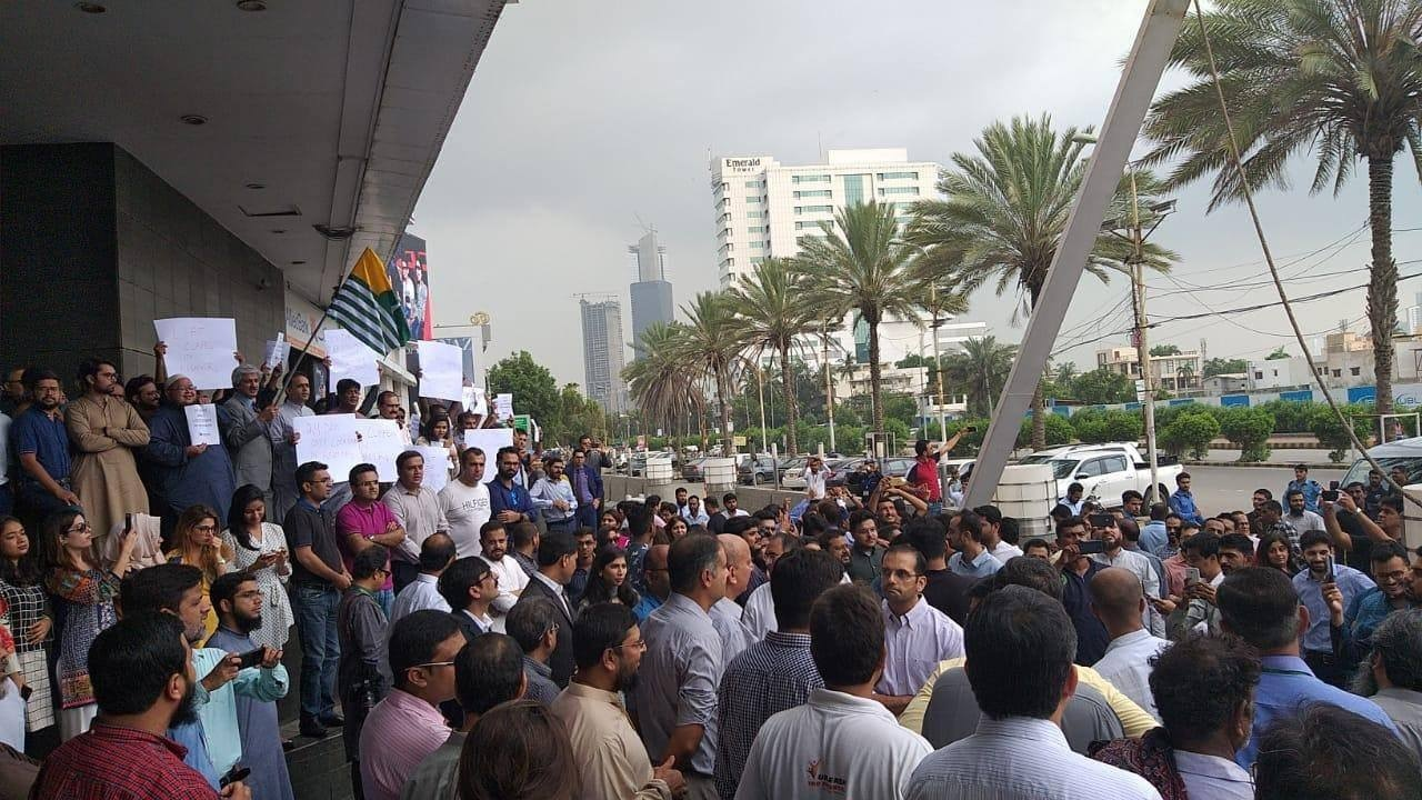People gather outside Ocean Mall in Karachi to observe Kashmir Hour. — Photo courtesy Usman Mazhar