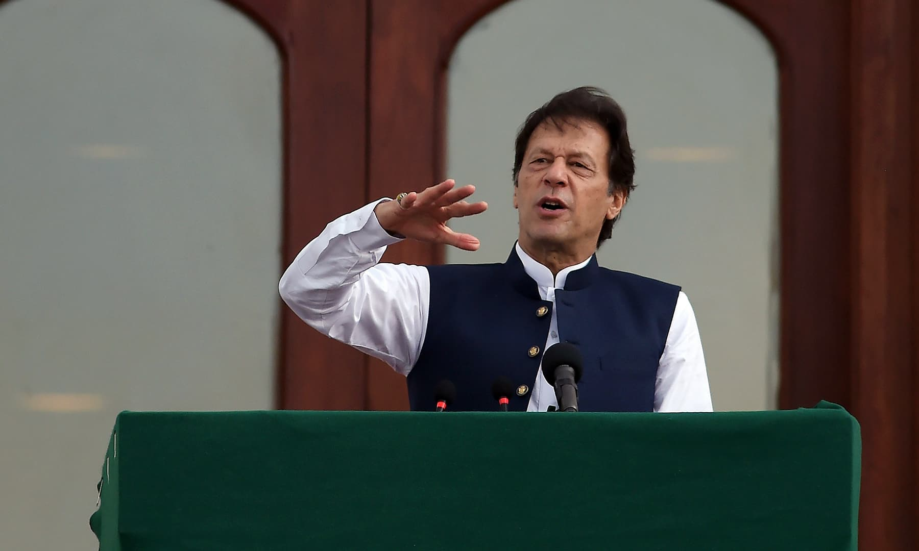 Prime Minister Imran Khan addresses the nation outside the Prime Minister's Office in Islamabad on August 30. — AFP