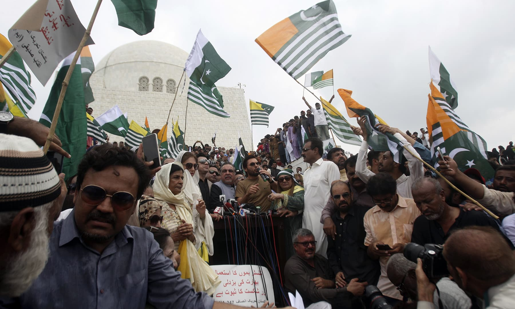 Protesters rally to express solidarity with Kashmiris at the mausoleum of Quaid-i-Azam Mohammad Ali Jinnah in Karachi on Friday. — AP