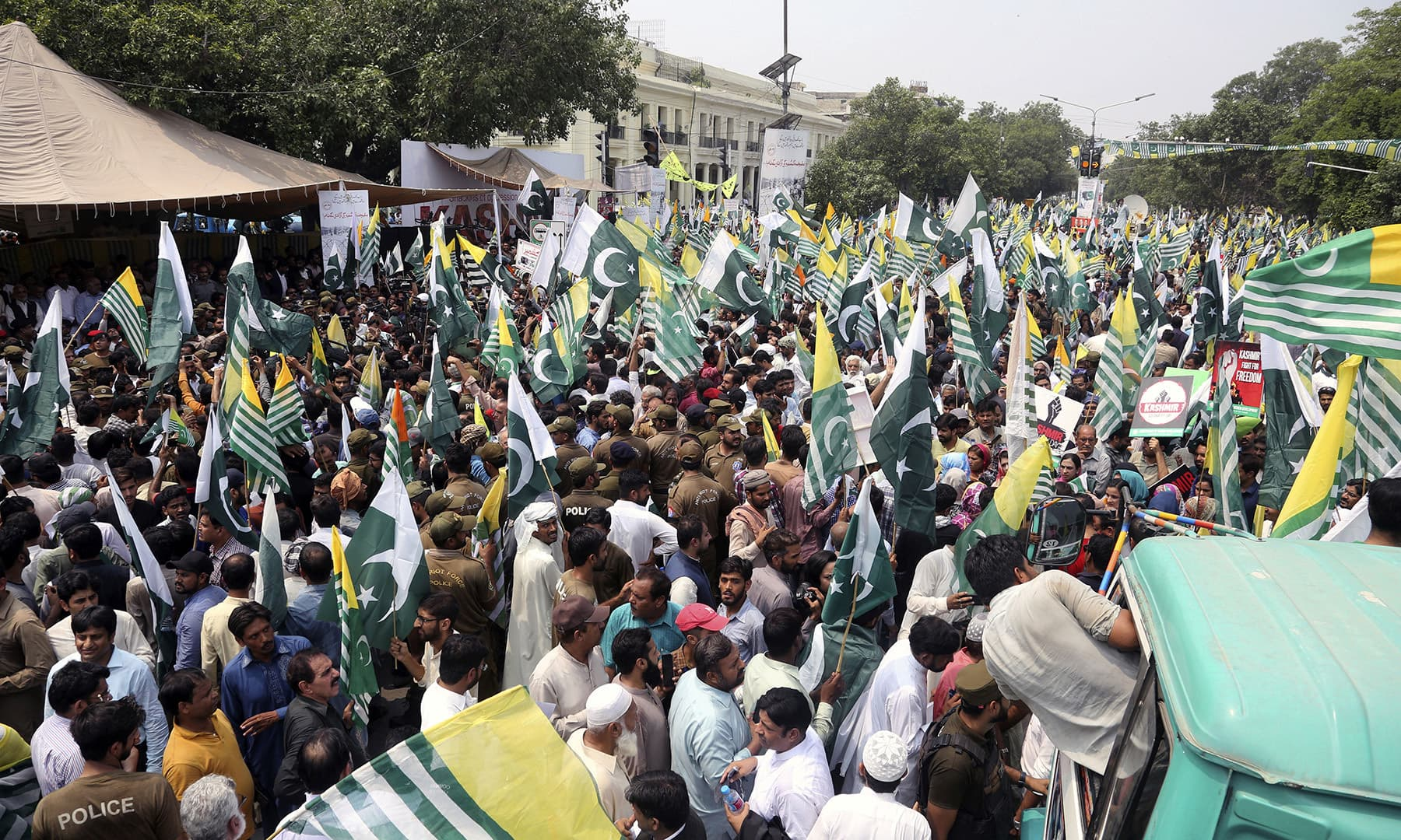 Protesters rally to express solidarity with occupied Kashmir in Lahore on Friday. — AP