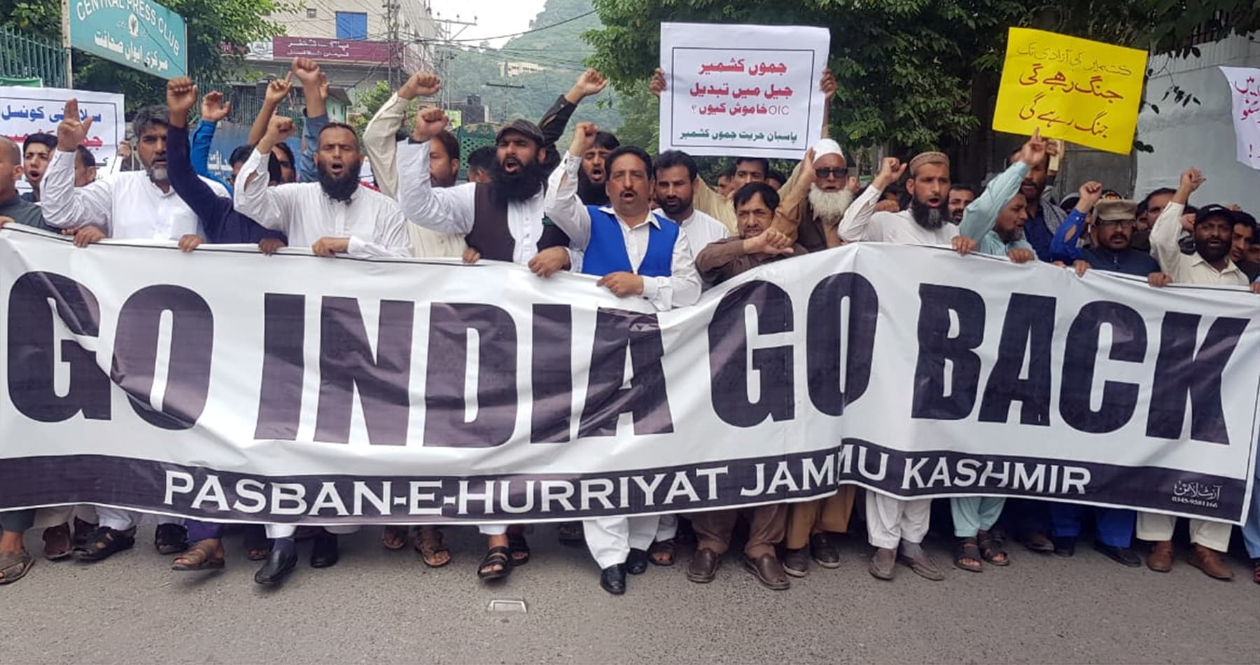 Civil society activists chant slogans at a rally organised by Pasban-e-Hurriyat Jammu Kashmir in Muzaffarabad. — Photo by Tariq Naqash