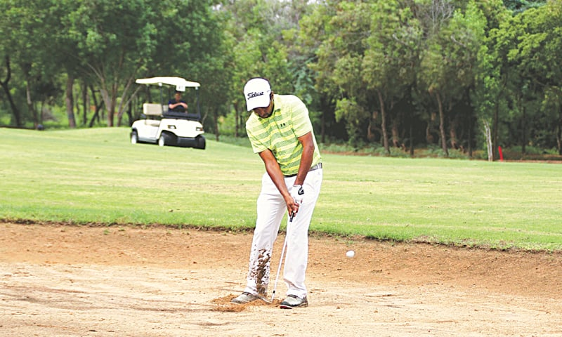 KARACHI: A competitor hits out from a bunker during the second round of the CNS Open Golf Championship at the Karachi Golf Club on Friday.