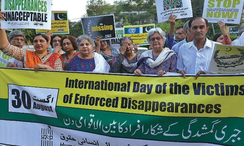 The placards demanded that 'enforced disappearance' be declared a crime. — APP/File