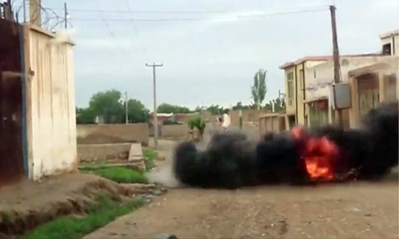An explosion is seen during heavy firing between the Taliban and Afghan forces on the street in Kunduz, Afghanistan on Saturday in this still image taken from a video obtained by Reuters.