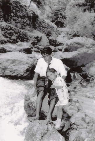 The writer, as a child, with his late uncle during a vacation in Iran, 1958
