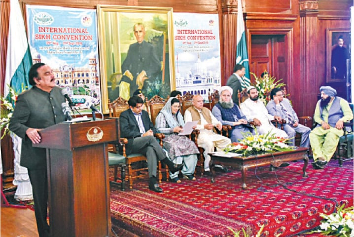 Prime minister's special assistant Naeemul Haq speaks at the International Sikh Convention organised at Governor House. — White Star