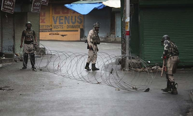In this file photo, Indian paramilitary soldiers close a street using barbwire in Srinagar in Indian occupied Kashmir. — AP