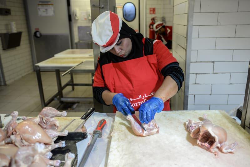 She's a pro at butchering chicken now. Photo courtesy: Murtaza Ali