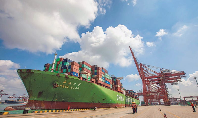 "This file photo, taken on August 6, 2019, shows a cargo ship berthing at Qingdao port in China's eastern Shandong province. China has refused another planned port call by a US warship amid soaring tensions between the Pacific powers on trade, a US official said last week. ""We did recently receive word that it was inconvenient for them to host a previously planned port call to Qingdao,"" said Randall Schriver, the assistant secretary of defense in charge of Asia. Qingdao is a major port in eastern China that has long been considered strategic and has become a major hub for the country's ""Belt an"
