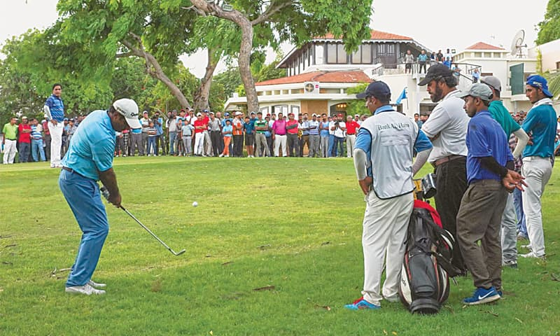 Matloob Ahmed chips on the playoff hole to seal the CNS Open Golf Championship title at the Karachi Golf Club on Sunday.—Mohammad Ali/White Star