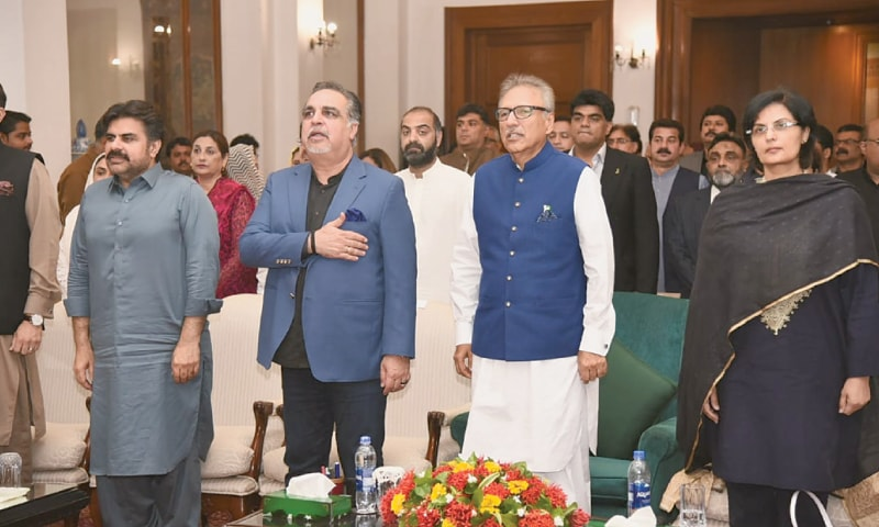 KARACHI: President Dr Arif Alvi, Sindh Governor Imran Ismail and Special Assistant to the PM Dr Sania Nishtar pictured during the programme at Governor House on Sunday.