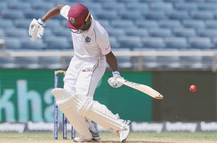 West Indies tailender Kemar Roach is hit by a Jasprit Bumrah delivery during the second Test at Sabina Park on Sunday.—AP