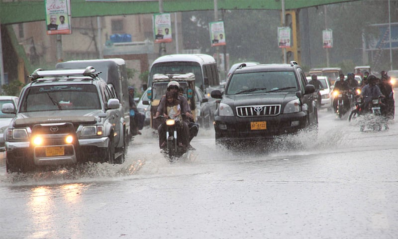SHAREA Faisal near the FTC building during heavy rain on Sunday.—Shakil Adil / White Star