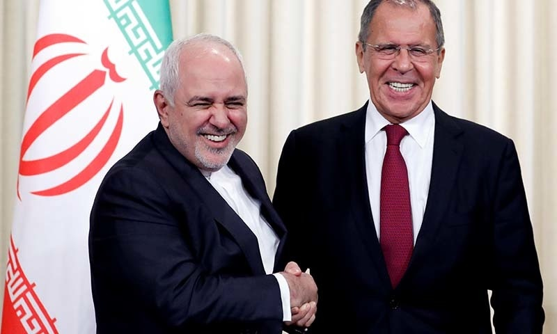 Russia's Foreign Minister Sergei Lavrov and his Iran's counterpart Javad Zarif shake hands after a news conference following their meeting in Moscow, Russia on September 2. — Reuters