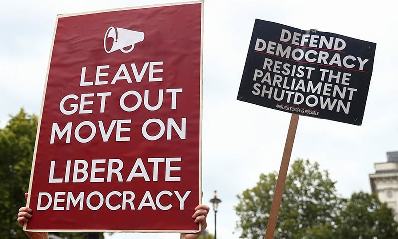 A pro-Brexit and an anti-Brexit placards are pictured at Westminster in London on September 3, 2019. — Reuters