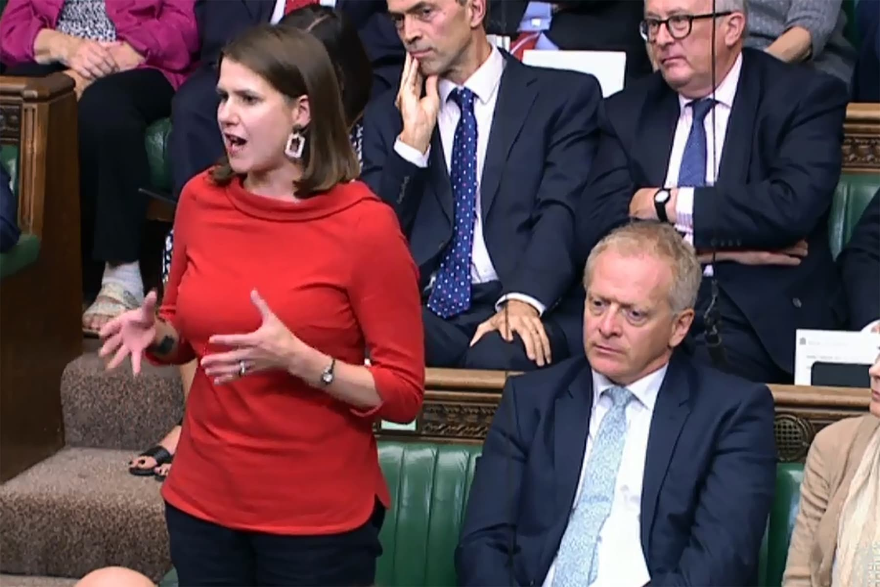 A video grab from footage broadcast by the UK Parliament's Parliamentary Recording Unit (PRU) shows former Conservative MP Phillip Lee (R) sitting next to Leader of the Liberal Democrats Jo Swinson (L) in the House of Commons in London on Tuesday. — AFP