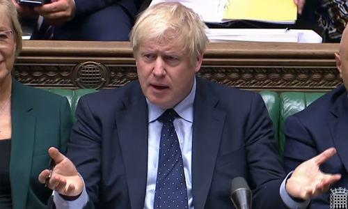 British PM suffers defeat in Brexit vote as rebels seize agenda