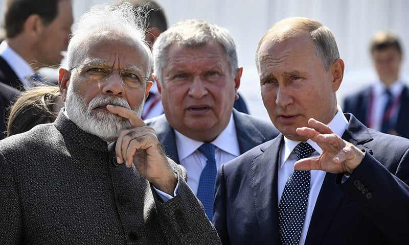 Russia's President Vladimir Putin speaks with India's Prime Minister Narendra Modi during a visit to the shipyard Zvezda, as Rosneft Russian oil giant chief Igor Sechin (C) accompanies them, outside the far-eastern Russian port of Vladivostok on September 4, 2019, ahead of the start of the Eastern Economic Forum hosted by Russia. — AFP