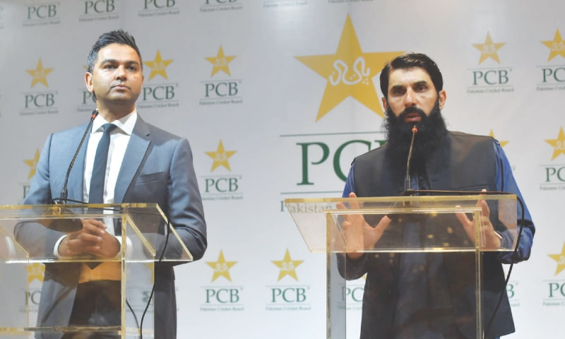 LAHORE: Newly appointed head coach-cum-chief selector of the national team Misbah-ul Haq (R) and Pakistan Cricket Board chief executive Wasim Khan attend a press conference on Wednesday.—M. Arif/White Star