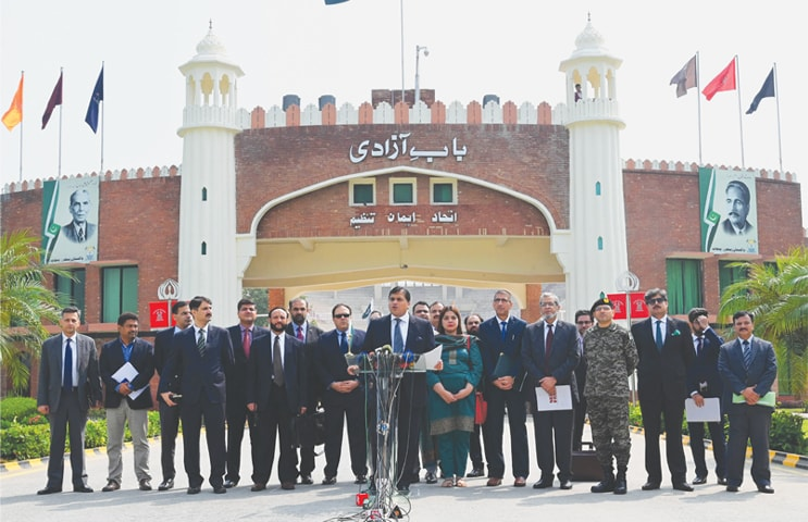 WAGAH BORDER CROSSING: Foreign Office spokesperson Dr Mohammad Faisal talking to journalists on Wednesday after a meeting with Indian officials about the Kartarpur corridor held in Attari, India.—M Arif / White Star