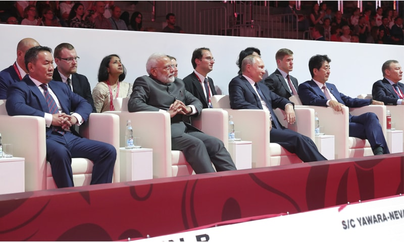 Indian Prime Minister Narendra Modi (left), Russian President Vladimir Putin and Japanese Prime Minister Shinzo Abe attend International Jigoro Kano Judo Tournament at the 5th Eastern Economic Forum in Vladivostok on Thursday.—AP