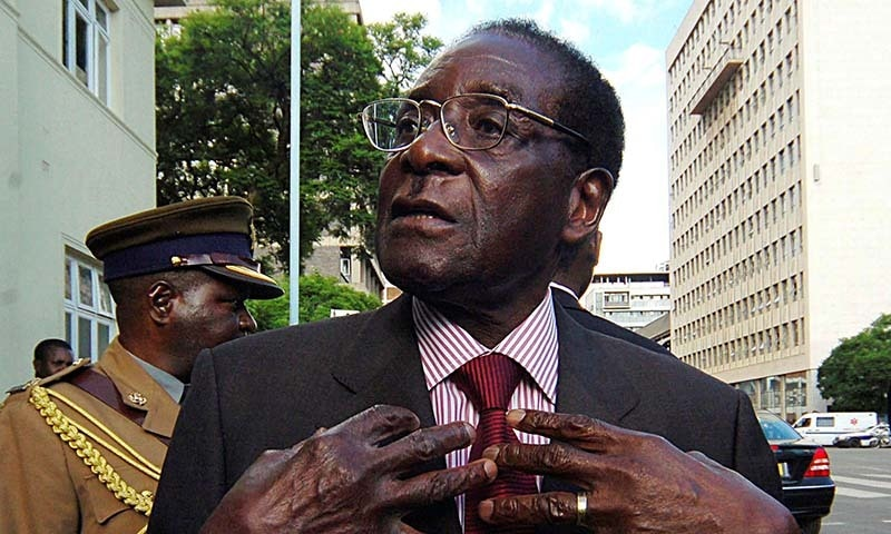 In this file photo,  Zimbabwe's President Robert Mugabe speaks to journalists outside Parliament in Harare on December 4, 2007. — Reuters