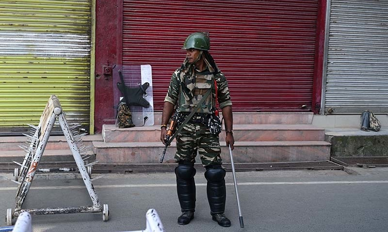 An Indian paramilitary trooper stands guard during a lockdown in Srinagar in occupied Kashmir on September 6. — AFP