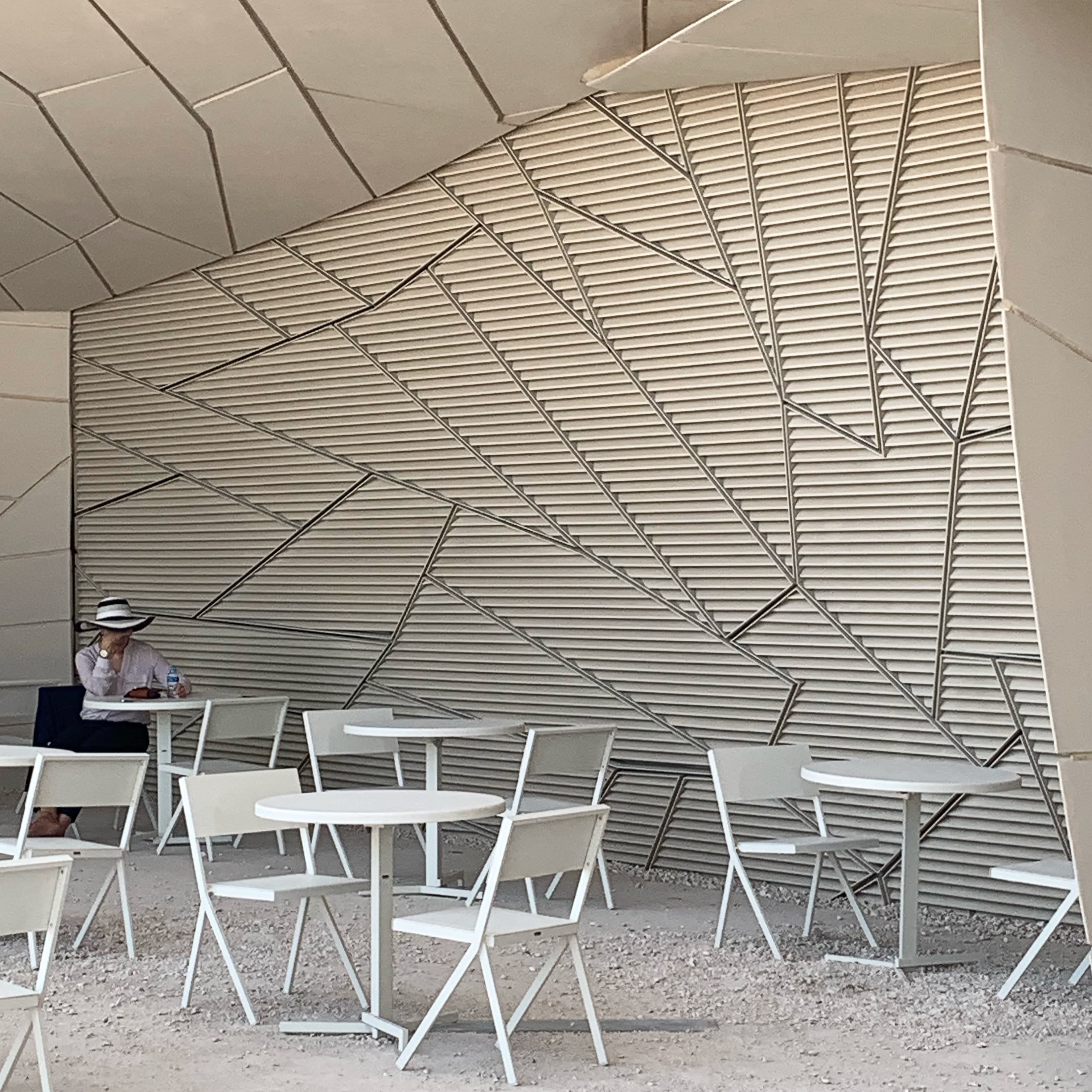 A visitor sits at the museum's outdoor café.
