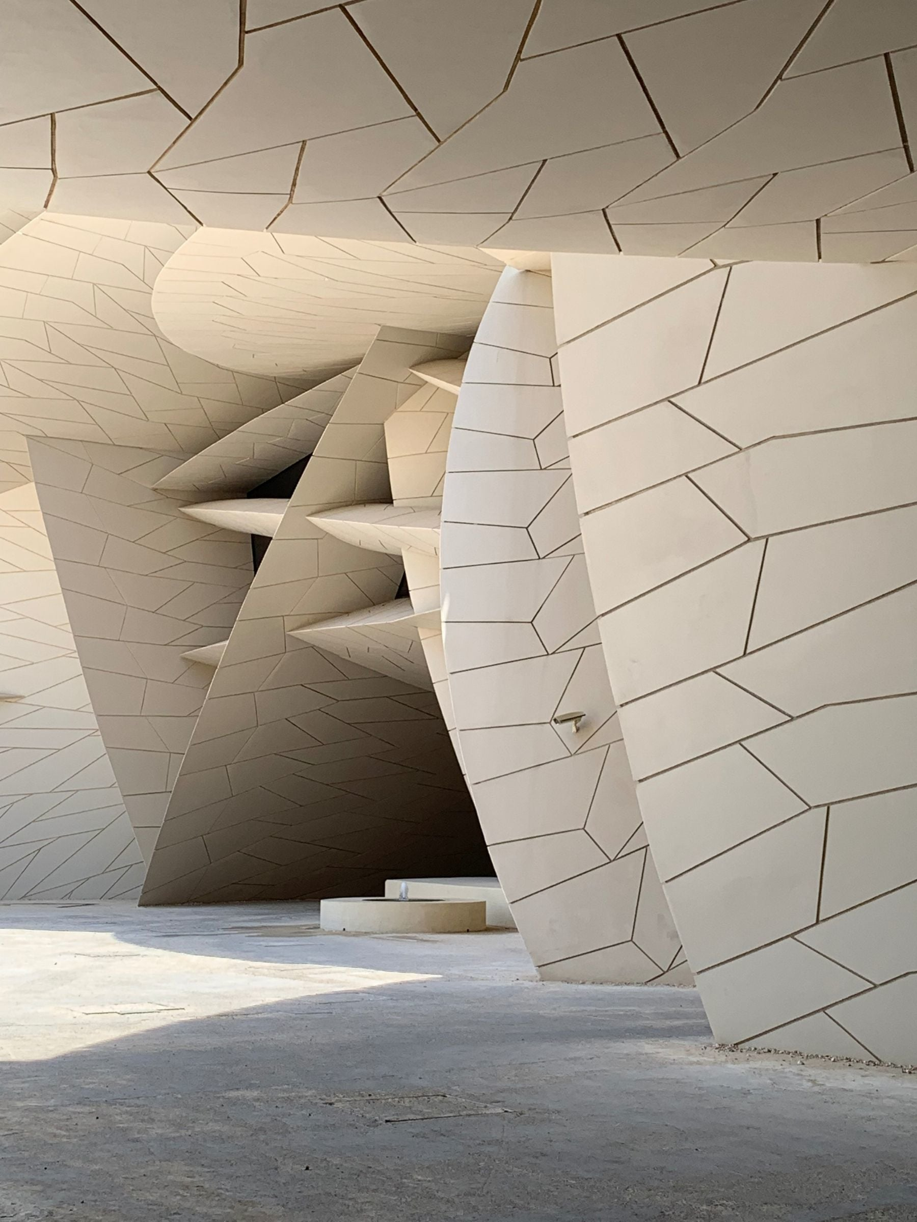 The sandy-beige coloured structure features a series of discs that appear to have crashed into each other.