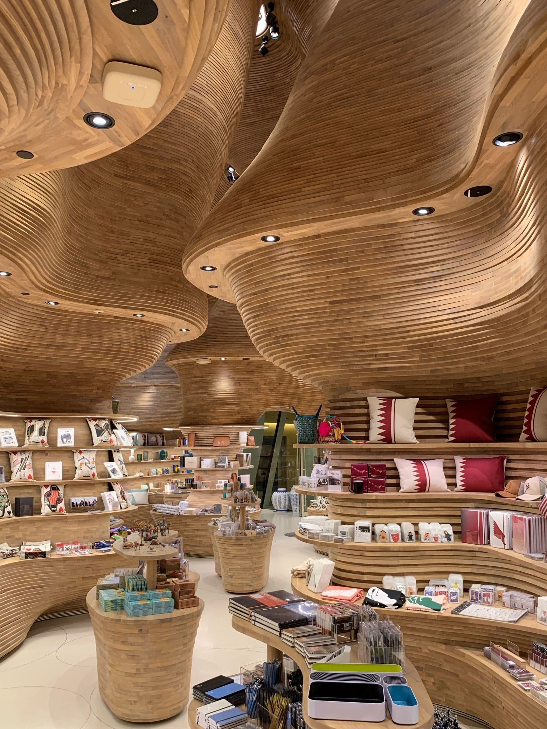 A cave in Qatar inspired the timber walls of the museum's shops, which have been designed by Koichi Takada Architects.