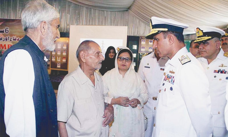 Commander Karachi Vice Admiral Muhammad Amjad Khan  Niazi interacts with family members of martyrs at a ceremony organised by  Pakistan Navy on Defence Day.—APP