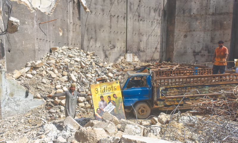 KARACHI: A poster for a Bollywood blockbuster starring Aamir Khan lies in the rubble of Prince Cinema.—Fahim Siddiqi/White Star