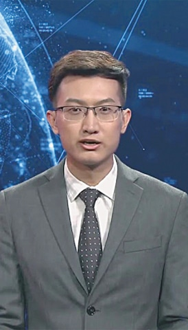 The English-language newsreader pictured here is modelled on Zhang Zhao, an actual anchorperson at Xinhua | Reuters