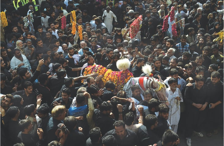 The main Zuljinah procession on its way to Gamay Shah, Lahore | White Star