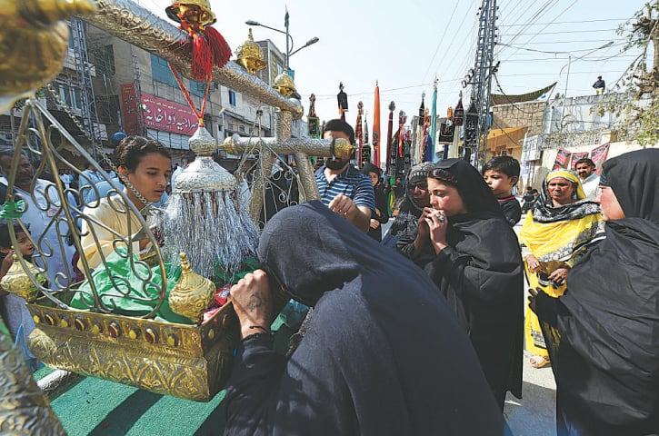 Women pay respects to the tazia in Peshawar | White Star
