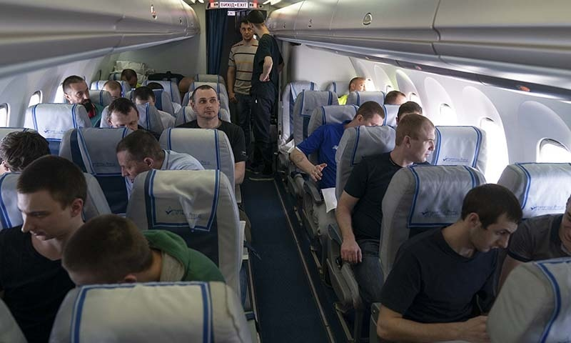 Prisoners aboard a plane on the way to Ukraine travelling to Boryspil airport, outside Kyiv, Ukraine, on September 7. — Ukrainian Presidential Press Office via AP