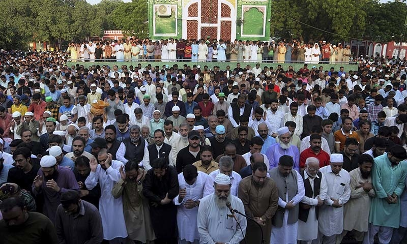 People offer funeral prayer of former cricketer Abdul Qadir, in Lahore on September 7. — AP
